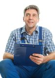Confident service man taking notes Stock Image