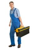 Confident service man with toolbox Stock Photo
