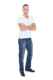 Confident sexy attractive young man in jeans and a t-shirt Royalty Free Stock Photography