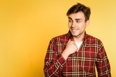 Confident man lustful smile leer feeling. Confident man with lustful smile and a leer gazing longingly sideways. feeling aroused and interested. portrait of a royalty free stock image