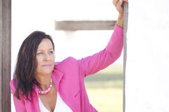 Confident sexy mature woman in pink Royalty Free Stock Photography
