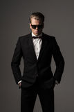 Confident sharp dressed man in black suit Royalty Free Stock Photos