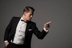 Confident sharp dressed man in black suit Stock Photos
