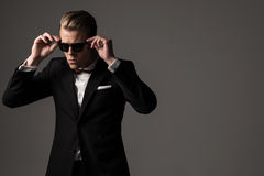 Confident sharp dressed man in black suit Royalty Free Stock Photography
