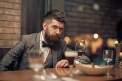 Confident sharp dressed man with glass of wine.  royalty free stock photos