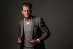 Confident sharp dressed man in grey jacket. Confident sharp dressed man in grey jacket Stock Photography