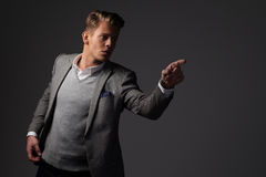 Confident sharp dressed man in grey jacket. Confident sharp dressed man in grey jacket Stock Images