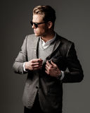 Confident sharp dressed man in grey jacket. Stock Images