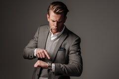 Confident sharp dressed man in grey jacket. Stock Image