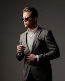 Confident sharp dressed man in grey jacket. Royalty Free Stock Photo
