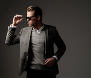 Confident sharp dressed man in grey jacket. Confident sharp dressed man in grey jacket Stock Photo