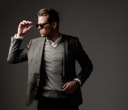 Confident sharp dressed man in grey jacket. Stock Photo