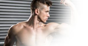 Confident shirtless man flexing muscles Royalty Free Stock Photos