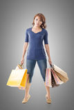 Confident shopping woman Stock Image