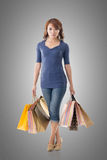Confident shopping woman Stock Images