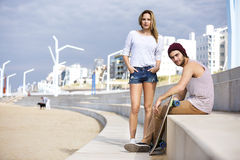 Confident Skateboarders On Steps At Beach Stock Images
