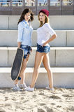 Confident Skaters On Beach Stock Photo
