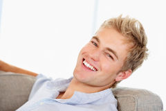 A confident smart male smiling confidently Royalty Free Stock Photos