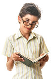 Confident smart teen with big glasses and book Royalty Free Stock Image