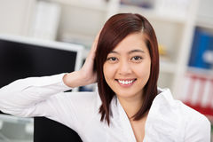 Confident smiling Asian businesswoman Stock Photo