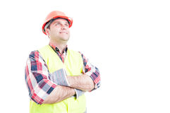 Confident smiling builder posing with arms crossed Royalty Free Stock Images