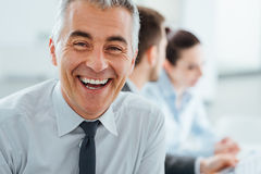 Confident smiling businessman posing Royalty Free Stock Photo