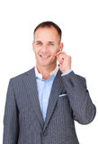 Confident smiling businessman using headset Royalty Free Stock Photos