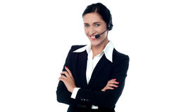 Confident smiling female customer support staff Stock Image