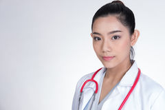 Confident smiling female doctor posing and looking at camera. Po. Rtrait of a young medical staff with positive attitude. asian physician or practitioner on stock photos