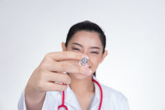 Confident smiling female doctor with a syringe in hand. Portrait Stock Image