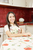 Confident smiling housewife Stock Photo
