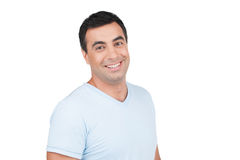 Confident smiling Indian man in blue T-shirt. Royalty Free Stock Photography