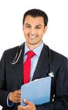 Confident smiling male doctor holding a clipboard with patient notes Stock Images