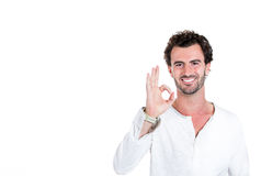 A confident smiling man showing OK sign Stock Photo