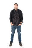 Confident smiling relaxed man in black jacket and ankle boots with hands in pockets. Full body length portrait over white studio background Royalty Free Stock Photos