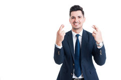 Confident smiling salesman or businessman making good luck gestu Stock Image