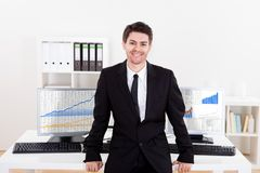 Confident smiling stock broker Stock Photography