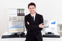 Confident smiling stock broker Royalty Free Stock Photo