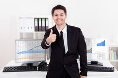 Confident smiling stock broker Royalty Free Stock Photography