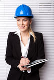 Confident Smiling Woman In Hard Hat Royalty Free Stock Photo