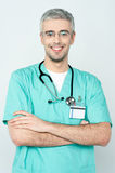 Confident smiling young doctor posing Stock Image