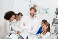 Confident smiling young male team leader royalty free stock photo