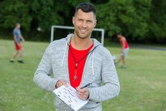 Confident soccer coach posing for photography stock image