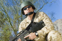 Confident Soldier Holding Rifle During War Royalty Free Stock Photo