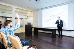 Confident speaker talking to audience on business training Royalty Free Stock Photo