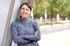 Confident sports woman smiling outdoors. Portrait of a confident sports woman smiling outdoors stock photography