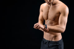 Confident sportsman using smart watch Royalty Free Stock Photo