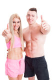 Confident sporty couple showing like gesture Royalty Free Stock Images