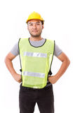 Confident, strong construction worker. On white background Royalty Free Stock Images