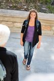 Confident Student With Backpack Walking On Campus. Portrait of confident mid adult student with backpack walking on college campus Stock Photo